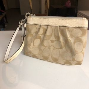 Coach wristlets in tan $ white canvas leather